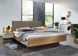 Rauch 20UP Partly Solid Wood Bed with Upholstered Headboard